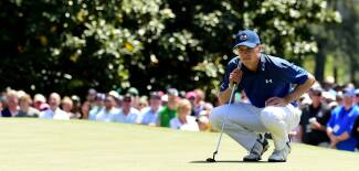 2017 Masters Tournament: Round 3 - Jordan Lines Up His Putt on the Opening Hole