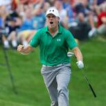 Jordan Spieth celebrates his advancement to the playoffs at John Deere following a miraculous bunker shot.