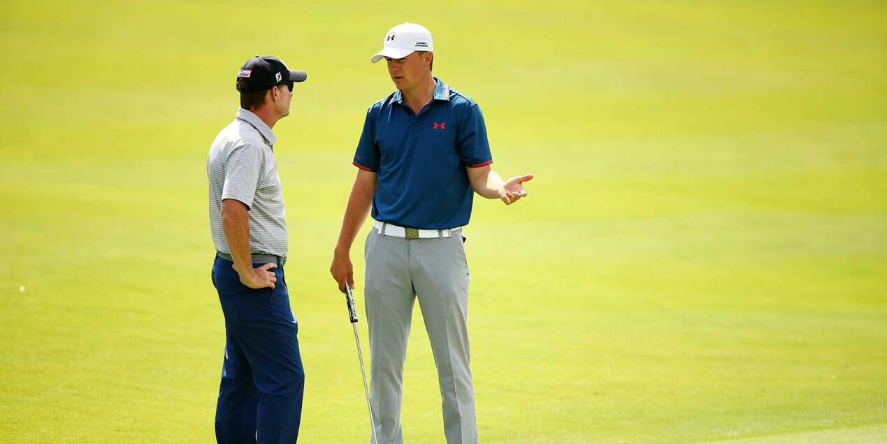 Jordan and Coach Cam McCormick Talk During Practice Round at The Australian Golf Course