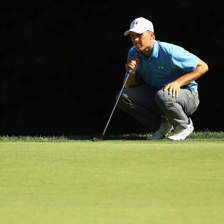 2017 Travelers Championship: Round 1 - Jordan Lines Up His Putt on No. 14