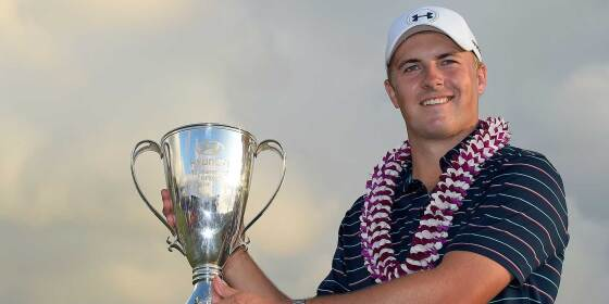 Jordan Poses With the Winner Trophy at the Hyundai Tournament of Champions