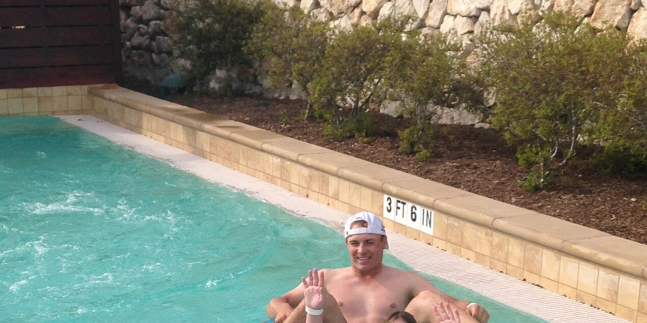 Jordan Spieth and sister Ellie Spieth in the pool after the 2014 Valero Texas Open
