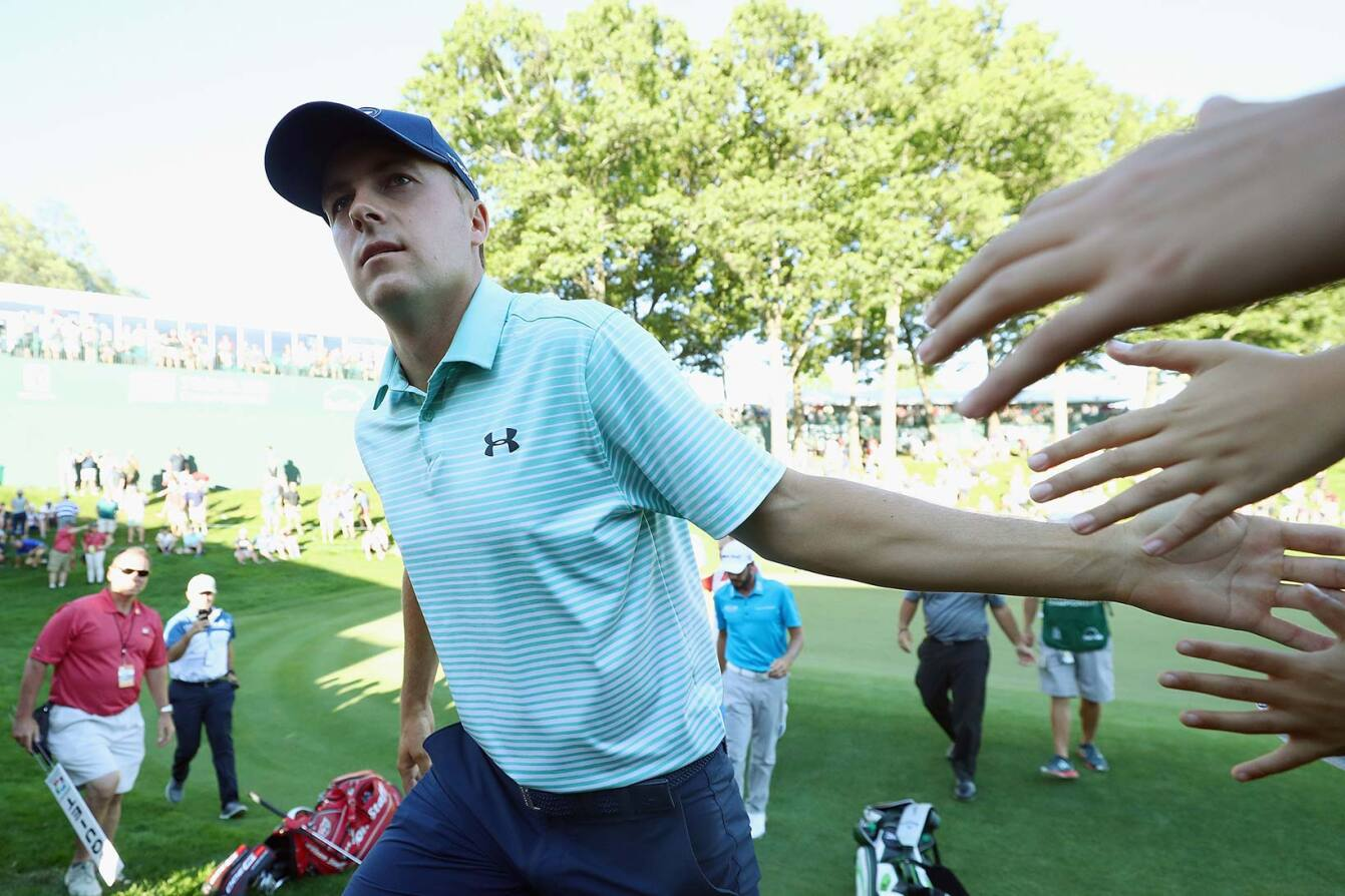 2017 Travelers Championship: Round 3 - High Fives Walking Off No. 18