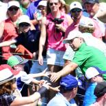 2017 Masters Tournament: Preview Round 2 - Greeting Patrons Off the Green on No. 18