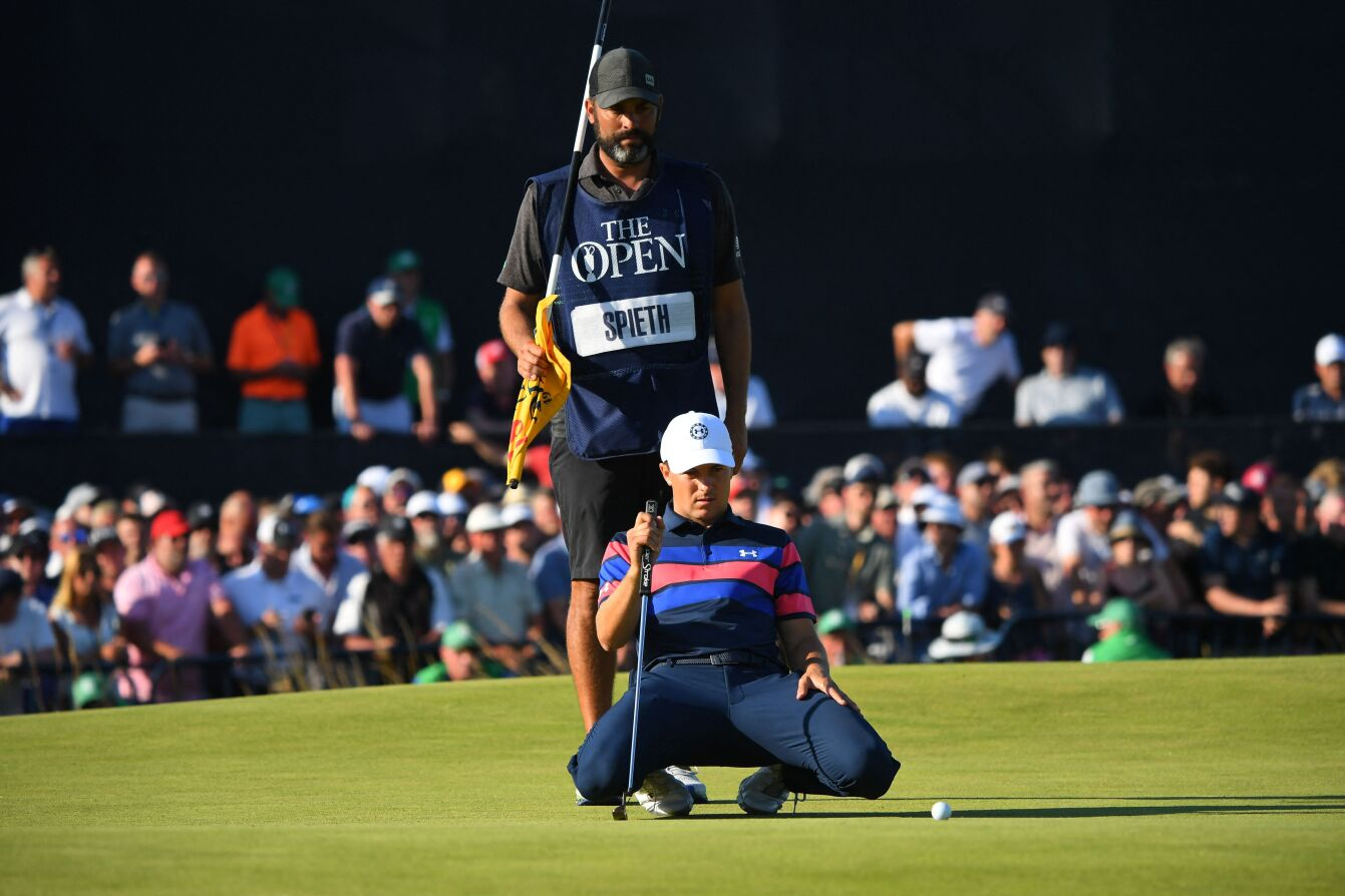US golfer Jordan Spieth lines up his put on the 18th green during his final round on day 4 of The 149th British Open Golf Championship at Royal St George's, Sandwich in south-east England on July 18, 2021